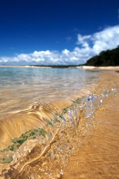Waves upon the shore summer blue sky beach ocean water nature clouds waves sea shore clear
