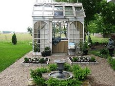 Greenhouse Inspiration: something to consider when I renovate the windows. It's far more preferable than throwing them away.