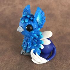 Sparkle Blue Gryphon Sculpture by Dragons and Beasties