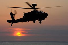 An Army Air Corps Apache attack helicopter takes off from HMS Illustrious.