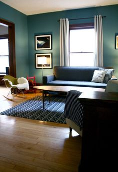 """Behr paint color """"Hallowed Hush""""Same room as another I've pinned, but a different angle. Still loving the teal walls and dark wood trim. Style At Home, Blue Grey Rooms, Blue Bedrooms, My Living Room, Living Spaces, Dark Wood Trim, Living Colors, Behr Paint Colors, Home And Deco"""