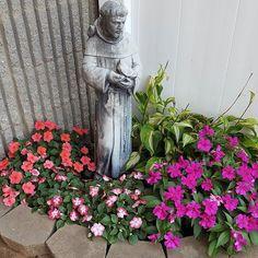 #MySundayPhoto flower beds, statue, church