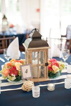 Wood lantern centerpieces | Coral & Navy Vintage Inspired Nautical Wedding At The Ribault Club Jacksonville Florida | Photograph by Britney Kay Photography