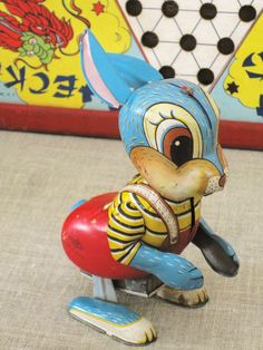 """""""When I was your age, all we had we could do is take drugs and stare at this goddamn rabbit!"""" - Vintage Japan Tin Toy Rabbit"""