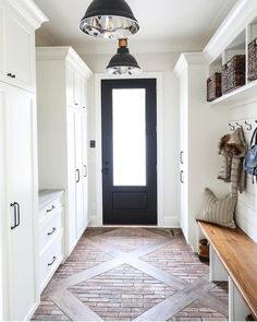 As soon as we saw this floor situation in this gorgeous mudroom! Custom floor pattern with wood and brick pavers + black mudroom door + white cabinetry + wood top bench seat with cubbies and hooks above Home Renovation, Home Remodeling, Flur Design, Design Design, Building A House, House Plans, New Homes, Room Decor, House Design