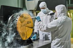 "Just like drivers sometimes use snow to clean their car mirrors in winter, two Exelis Inc. engineers are practicing ""snow cleaning'"" on a test telescope mirror for the James Webb Space Telescope at NASA's Goddard Space Flight Center in Greenbelt, Maryland. By shooting carbon dioxide snow at the surface, engineers are able to clean large telescope mirrors without scratching them."