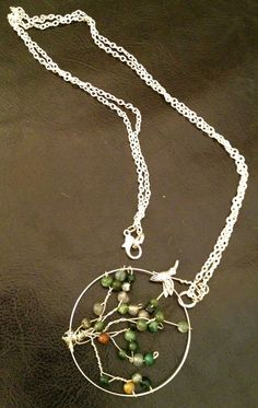 Green Jasper Tree of Life Necklace - Silver chain with silver and jasper tree of life. Long chain, hangs down to belly. Jasper is a grounding stone. Protective and independence enhancer. Little hummingbird flies around looking for a place to land.  Handmade by Julie Moore http://medicinemancrafts.com/collections/jewelry/products/green-jasper-tree-of-life-necklace
