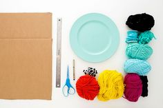 Use these materials to create a woven placemat. Easy Crafts To Sell, Diy And Crafts, Make Your Own Clay, Circular Weaving, Diy Notebook, Weaving Projects, Woven Wall Hanging, Weaving Techniques, Loom Knitting