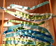 Reggio Emilia: Families Parents write their hopes and dreams for their child on a ribbon and weave it into the loom.