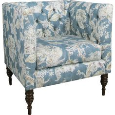 Accent a neutral seating group in the living room or create an inviting reading nook in the study with this elegant chair, showcasing blue floral upholstery ...