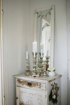 I like all the varied shapes and heights of these candlesticks. From a Swedish farm house