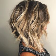 Summery blonde balayage with an angled wavy bob by Aveda Artist Kristine Marie.