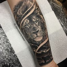 Men's forearm sleeve tattoo, lion with silhouette in realism
