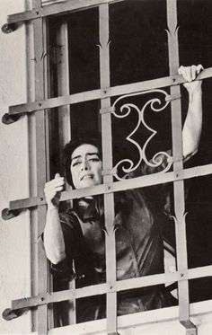 """Joan Crawford as Blanche, wheelchair bound, locked in her room by her demented sister Baby Jane Hudson, Bette Davis. In the classic grand guignol chiller """"What Ever Happened to Baby Jane?"""" 1962 vintage original still (detail)"""