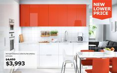 A kitchen with white and orange doors combined with white appliances, yellow leather chairs and