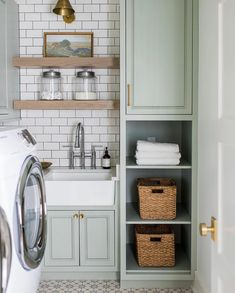 Soft sage green laundry room with cabinets, open shelving and farmhouse sink Laundry Room Colors, Paint Colors For Living Room, Laundry Room Design, Laundry Room Remodel, Laundry Room Cabinets, Kitchen Cabinets, Island Kitchen, Farmhouse Laundry Room, Country Farmhouse Decor