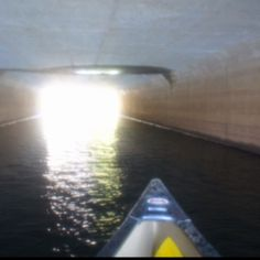 """Follow the light to the river. Paddling an Old Town """"pack"""" canoe. Traveling form Long Pond Brimfield  to the Quinebaug River in Holland."""