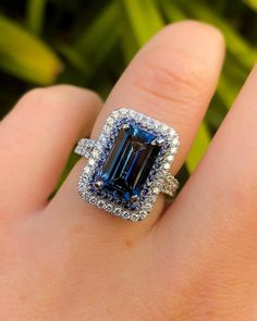 Emerald Cut Blue Sapphire Engagement Ring with a double halo #princessbridediamonds #sapphire #emeraldcut #engagementring #diamondrings #diamondjewelry #sapphirerings
