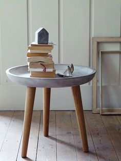 Junkyjoey  A concrete bowl attached to set of stool legs makes a great little table....for inside or out! ( would make a charming birdbath too!)