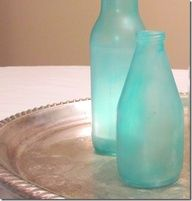 DIY Beach Glass      Directions:    1) Start with clean, dry glass bottles and jars and prepare your workspace.  2) Mix the school glue and water as if you were making homemade mod podge.  Just mix 2-3 parts glue to 1 part water.  3) Add a few drops of blue and green food coloring. Add more blue or green depending on your preference.  Add just a little dish liquid.
