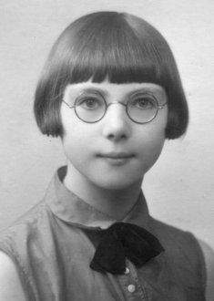 In the 1920s eyeglasses are a fashion statement and round frames are dominant. Circa 1929.