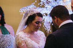 Bride in vintage wedding veil during wedding ceremony at Langley Hall.