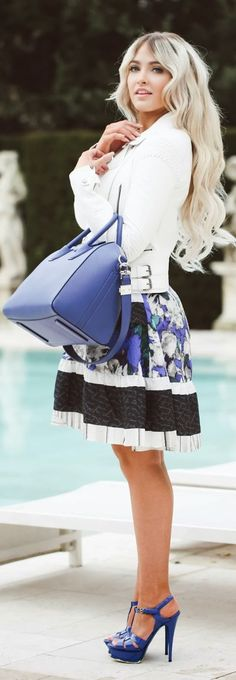 blue, white and black striped and floral skirt with an interesting pattern paired with a bag in the same shade of blue (+ love the hair color!)