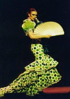Green polka dots on white with large cascading ruffles & train.