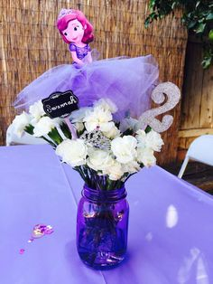 Purple mason jar centerpieces at a Sofia the First birthday party! See more party planning ideas at CatchMyParty.com!