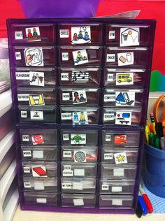 Organize visuals/schedule pictures... This is a lot prettier than the overflowing drawer in my classroom.