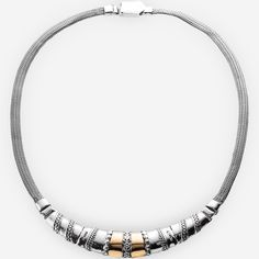 Two tone silver collar necklace features a three-segment plate with sterling silver flower motif and sleek 14k gold details with a thick herringbone chain.  https://zanfeldjewellery.com/wholesale/necklaces/two-tone-silver-collar-necklace-floral/
