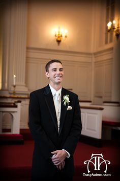 cute first look photo idea at robert car chapel on tcu campus.   Seeing bride first time. Photo by Tracy Autem Photography.  white boutonniere by tami winn floral.