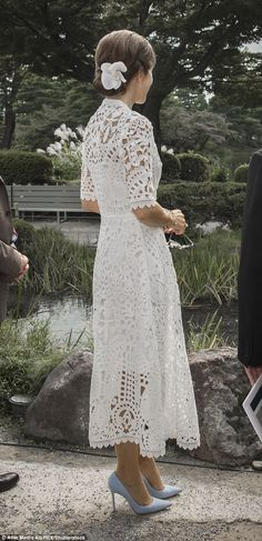 The royal, 45, looked every inch the fashion icon in a white lace dress by Temperley Lonodon, one of Kate's favourite designers as she visited the Kenrokuen Garden in Kanazawa, Japan.
