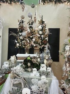 Various ornaments and decor in our Winter Elegance vignette blending rich colors of gold, silver, and white. www.treetime.com