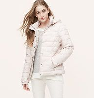 """Packable Puffer Jacket - A perfect portable, we're into the get-up-and-go cool of this simply soft and cozy packable style. Includes drawstring carry pouch. Hooded. Long sleeves. Snap and zip front. Side zip pockets. Elasticized rib knit cuffs. Lined. 24"""" long."""