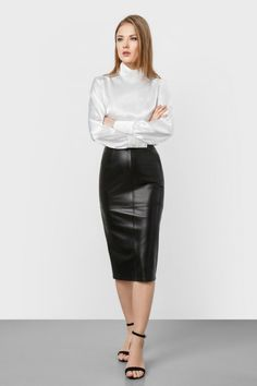 White satin long sleeve blouse with black leather skirt