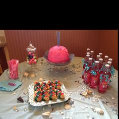 Pink bomb cake and drinks table