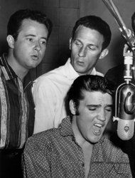 The Jordanaires sang back up on a Kelly Foxton and Hank Snow RCA album.  Gordon Stoker was a really nice man and fun to work with!    This undated image released by the Country Music Hall of Fame shows Elvis performing with the Jordanaires' Gordan Stoker, left, and Hoyt Hawkins. Stoker, a member of The Jordanaires vocal group that backed Elvis Presley, died Wednesday, March 27, 2013 at his home in Brentwood, Tenn., after a lengthy illness. He was 88. (AP Photo/Country Music Hall of Fame)