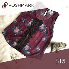 "✨Plum Floral Sleeveless Blouse! ✨ ✨Plum Sleeveless floral blouse with lace strip down the front and a back key hole. Brand is Dream Out Loud By Selena Gomez. Made of 100% Polyester. Front Length 24"". Back Length 25"". Width 18"".✨ Tops Blouses"