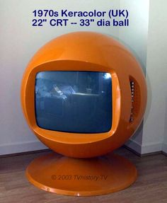 1970 TV - I still have mine!  It's black and hangs from a chain. <3