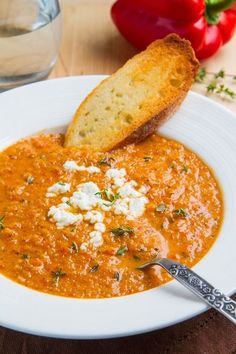 {Creamy roasted red pepper and cauliflower soup with goat cheese.}.
