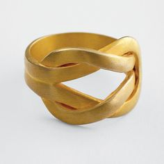 love knot ring | A thoroughly modern statement of love and strength, this high-design ring's inspiration dates all the way back to the fifth century, when the classic love knot was a symbol of unity and loyalty, in addition to affection. Bold lines and a brushed gold finish bring it into the 21st century.