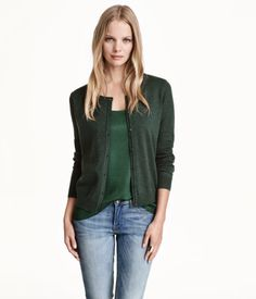 Fine-knit cotton cardigan with long sleeves. Round neck, buttons at front, and rib-knit hem and cuffs.
