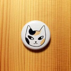 A curious little calico to adorn your backpack, tote bag, cardigan, etc.  1 inch pinback button designed in Sunny California.