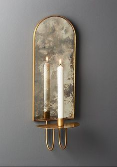 light reflections Curved iron wall sconce in brass finish holds one taper candle Antiqued mirror backing brilliantly reflects the light We love it in pairs flanking a bed or doorway or clustered in multiples for extra drama exclusive Wall Lights, Candle Sconce Bedroom, Brass Wall Light, Mirror Wall Decor, Wall Candles, Candle Sconces, Candle Sconces Living Room, Wall Candle Holders, Wall Sconce Hallway