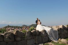 """""""King and Queen  of #Bulgaria #RusevandLanaWedding"""" - On Friday, September 2, 2016, Miroslav Barnyashev (WWE Superstar Alexander Rusev) and CJ Perry (WWE Diva Lana) held a second wedding in Plovdiv, Bulgaria, which is his native country. The bride wore a custom wedding gown by designer Olia Zavozina for the traditional Bulgarian wedding. The couple's first wedding was on July 30, 2016 in Malibu, California. The weddings will be featured on the sixth season of the reality show Total Divas…"""