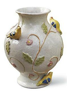 Handmade and handpainted in Italy using traditional glazing and firing techniques, this decorative vase brightens any space indoors or outside.