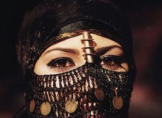 "Arabian Eyes, By mnadi    I didn't take this shot which was used in a local Vodafone campaign a few years back. This Arabian beauty from Sinai, Egypt is wearing a traditional bedouin head dress (that is covered with golden coins) to show her exotic eyes that are covered by an ancient dark makeup called ""Kohl"" originally used by the early Arabs and in ancient Egypt."