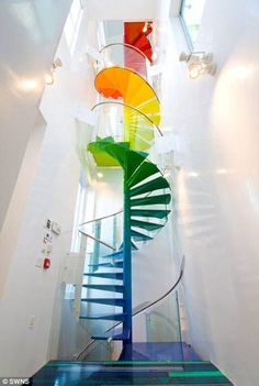 rainbow-colored spiral staircase is one of the home's focal points.