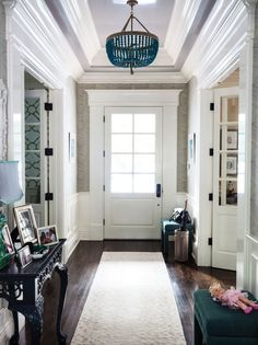 24 Foyers You'd Be Happy to Come Home to via Brit + Co. - Amazing mouldings.